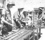Soldiers preparing ammunition for the fighters